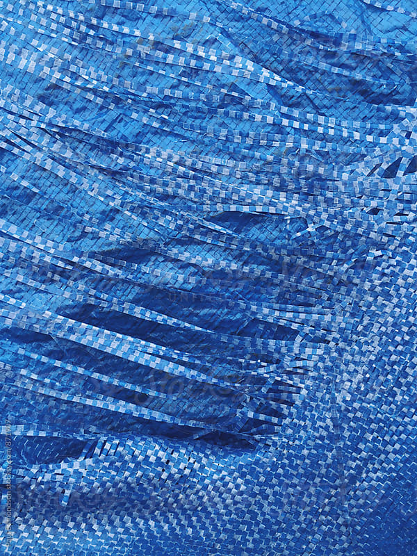 Close up of worn blue tarp by Paul Edmondson for Stocksy United