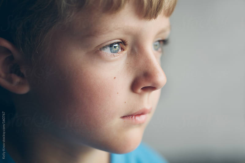 portrait of a young boy by Kelly Knox for Stocksy United