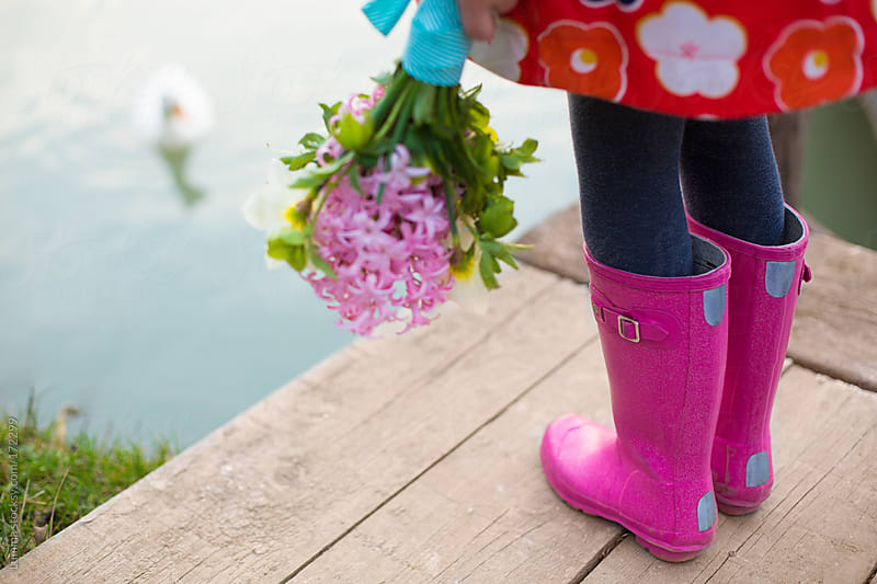 Girl in Pink Boots Holding Flowers by Lumina for Stocksy United