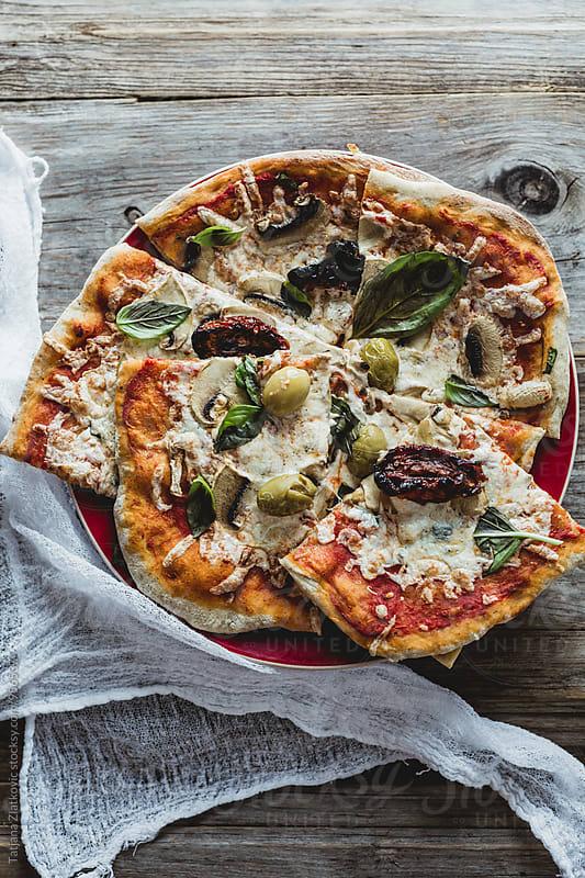 Homemade pizza by Tatjana Zlatkovic for Stocksy United