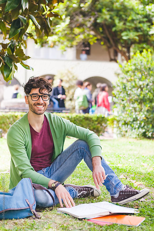 Young Man Studying in the Courtyard of a College Campus by Giorgio Magini for Stocksy United