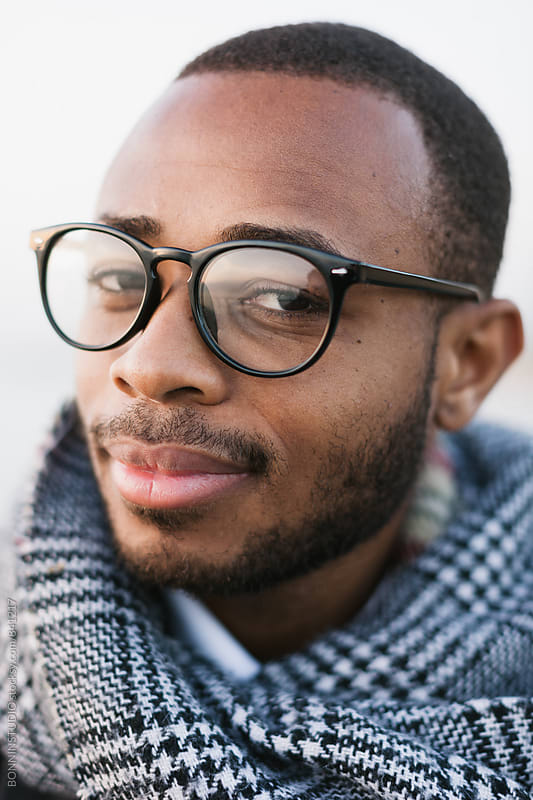Closeup portrait of an african american man on winter. by BONNINSTUDIO for Stocksy United