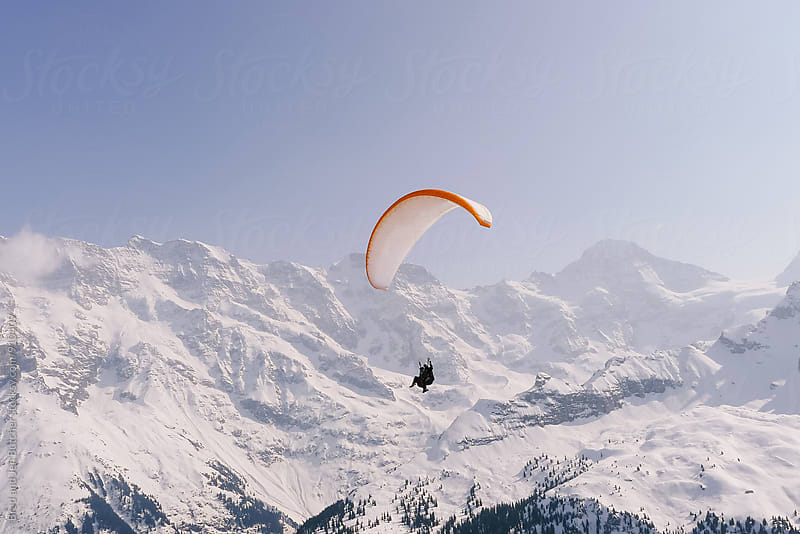 Paragliding in the Alps by Brad and Jen Butcher for Stocksy United
