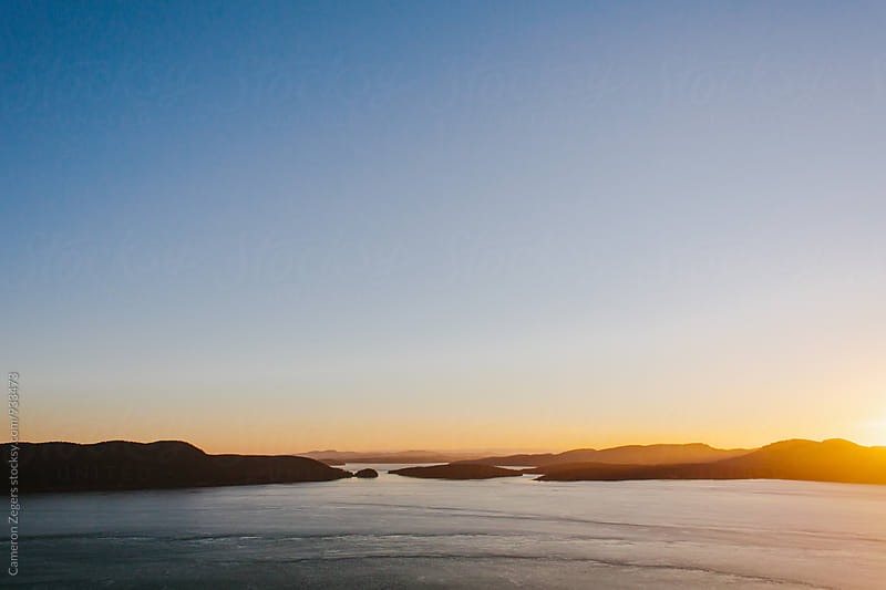 sunset over San Juan Islands, Washington by Cameron Zegers for Stocksy United