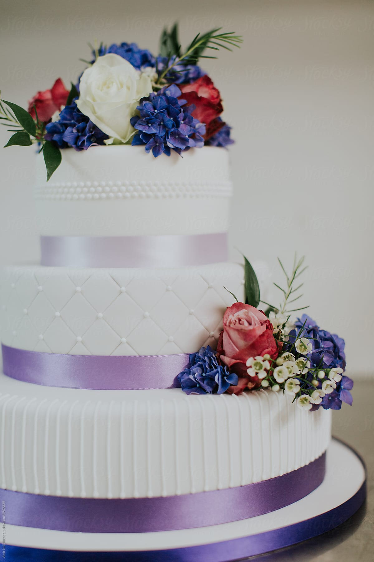 Colorful Purple And White Designer Wedding Cake Stocksy United