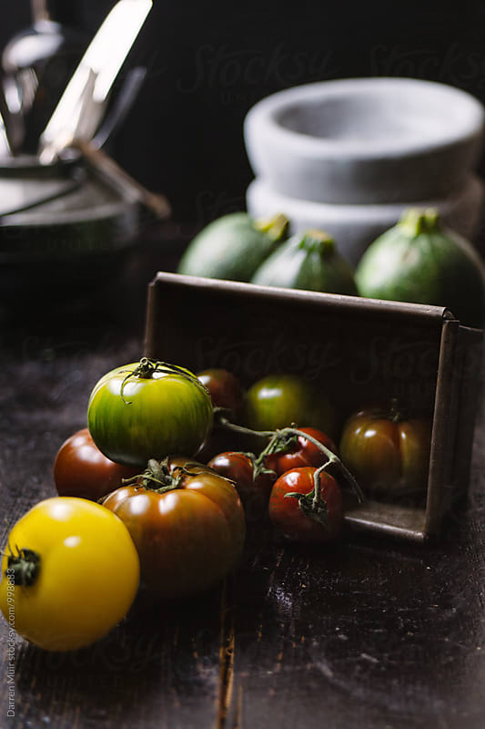Heirloom tomatoes. by Darren Muir for Stocksy United