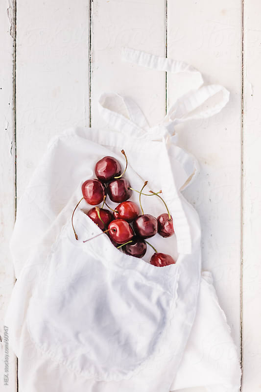 White Apron With Cherries  by HEX. for Stocksy United