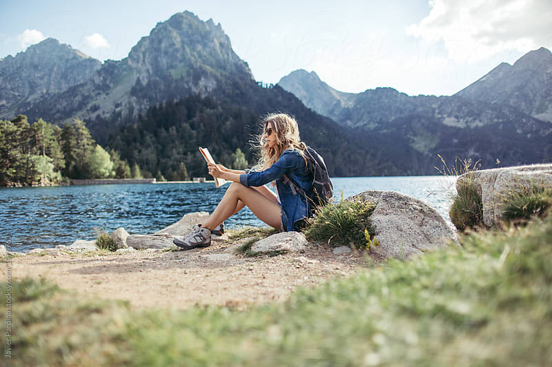 blonde woman exploring and enjoying nature by Javier Pardina for Stocksy United
