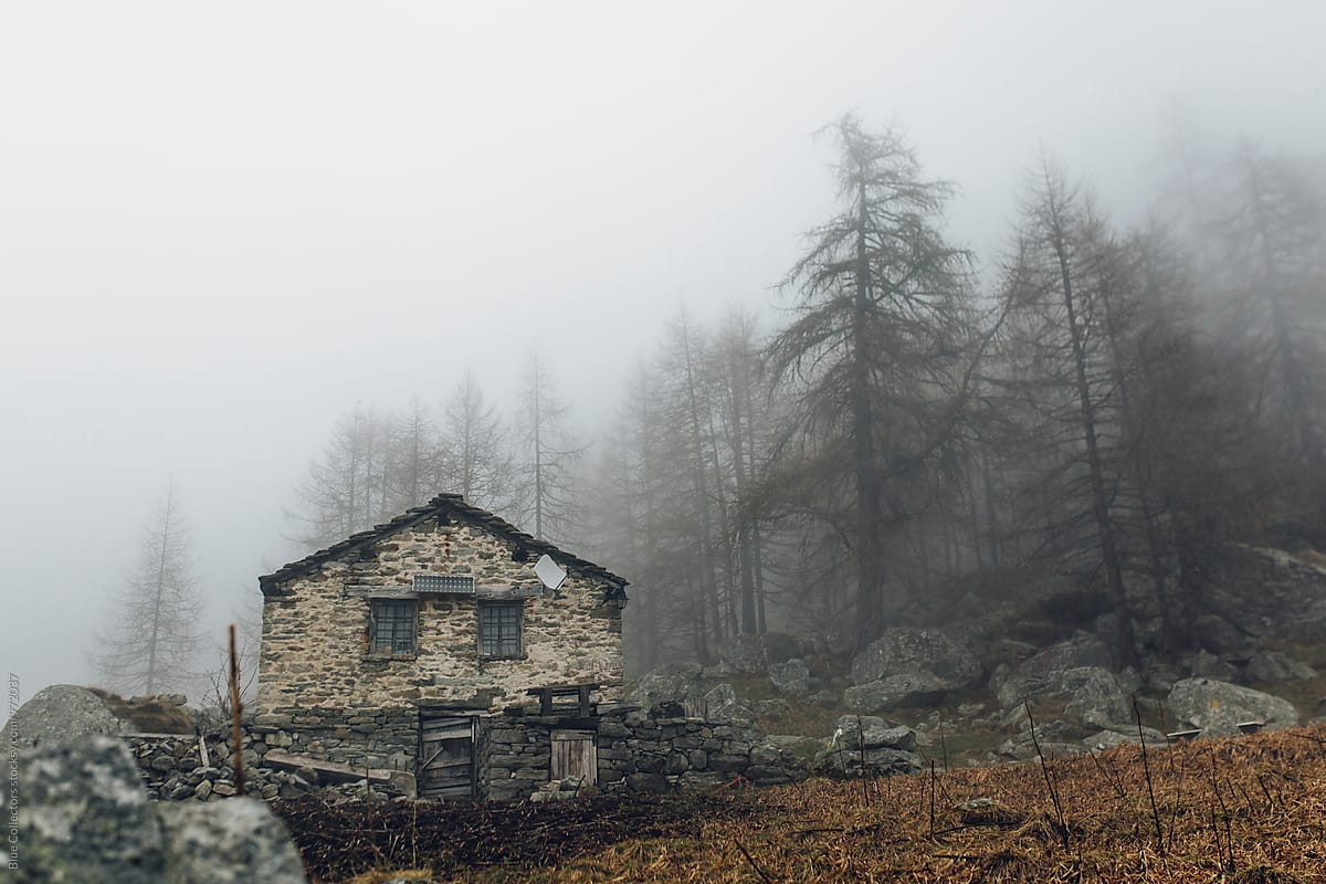Traditional Stones Cabin Of Alps Into The Foggy Forest By Blue Collectors Mountain Cabin Stocksy United