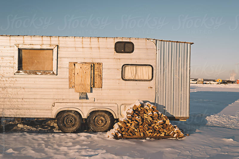 Caravan home on snow covered landscape by Preappy for Stocksy United