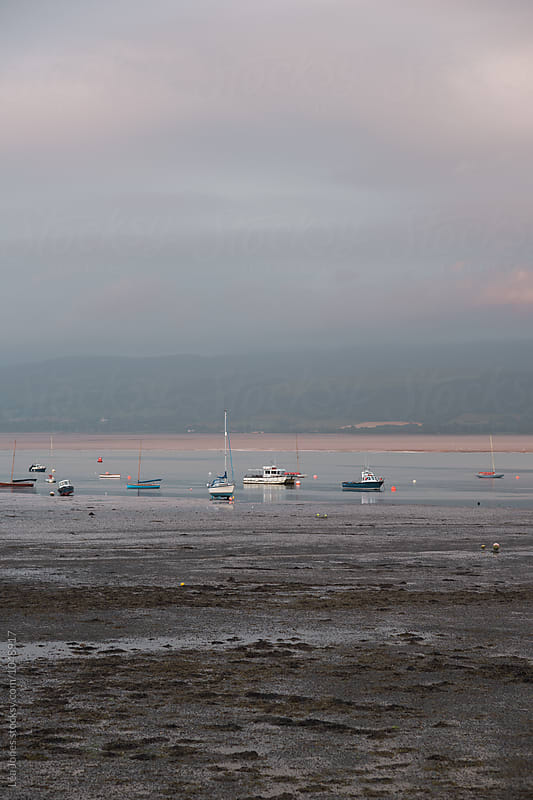boats on low tide at sunset by Léa Jones for Stocksy United