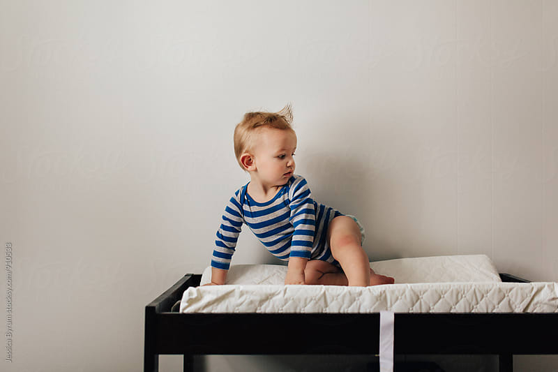 Child On Changing Table by Jessica Byrum for Stocksy United