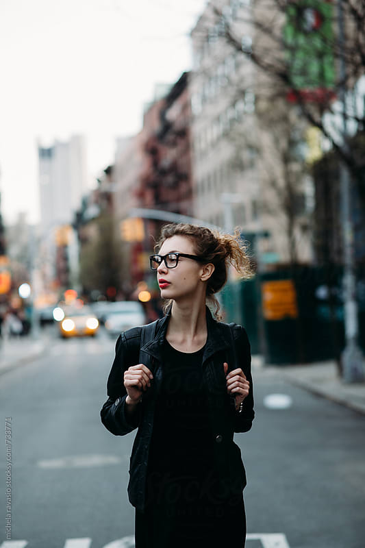 Attractive young woman walking in the street in New York City by michela ravasio for Stocksy United