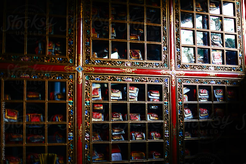 Bookcase in Buddhist temple by Artem Zhushman for Stocksy United