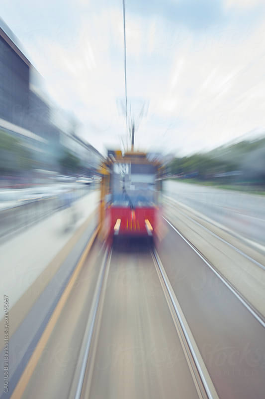 Motion blurred tram  by CACTUS Blai Baules for Stocksy United