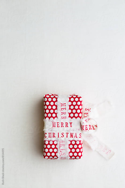 Christmas gift with hand stamped ribbon by Ruth Black for Stocksy United