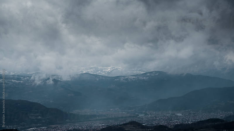 Dramatic Sky Over the Town and the Mountains by Branislav Jovanović for Stocksy United