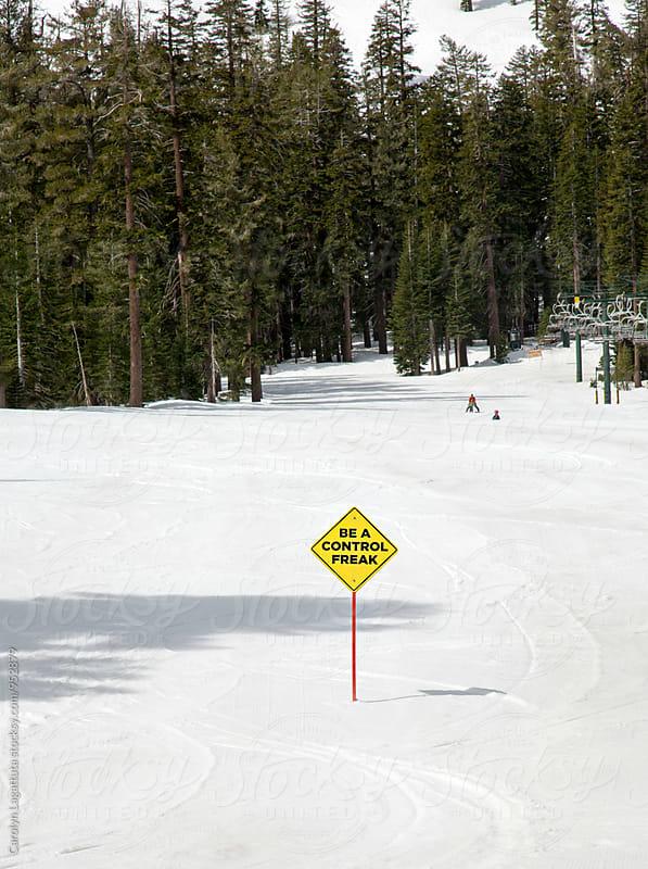 Sign in the snow saying Be a Control Freak by Carolyn Lagattuta for Stocksy United