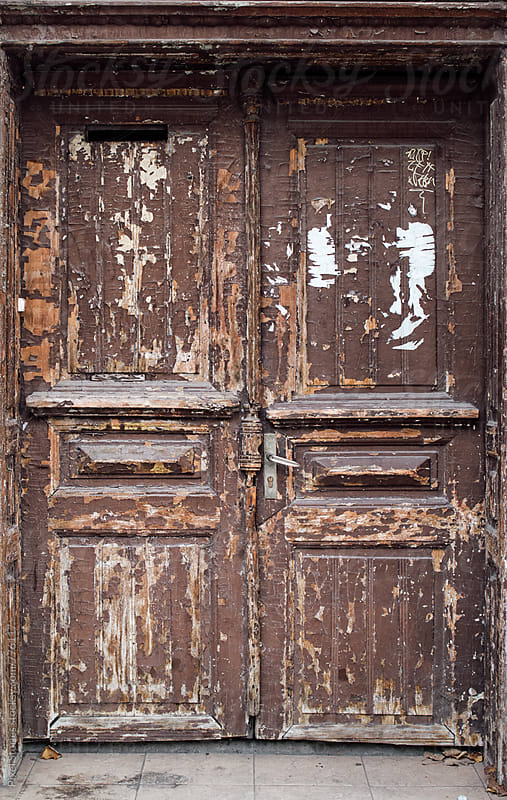 Brown weathered door by Pixel Stories for Stocksy United