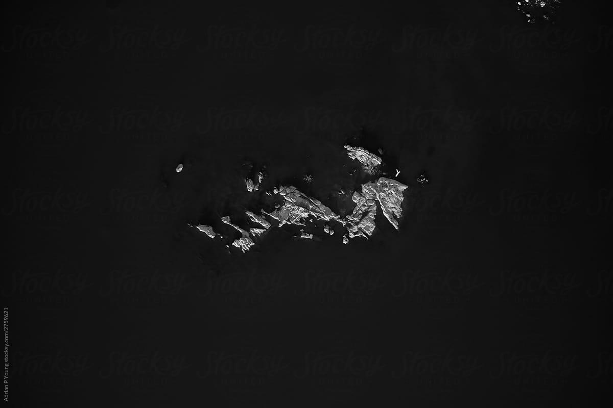 Rock island in lake aerial