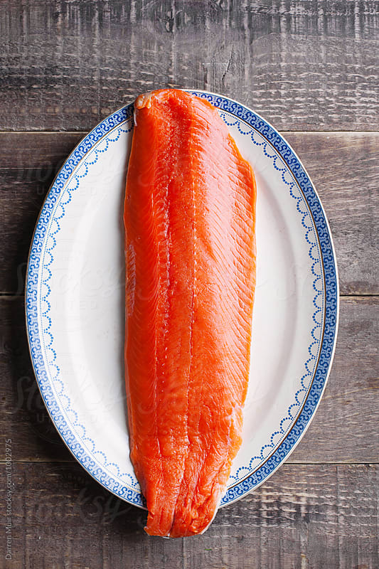 Series showing the making of salmon gravlax from start to finish. Raw salmon. by Darren Muir for Stocksy United