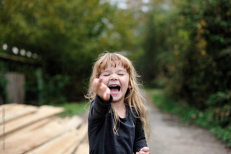 Laughing little girl by Sveta SH for Stocksy United