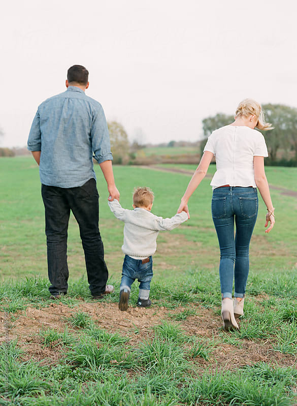 Family walking together by Marta Locklear for Stocksy United