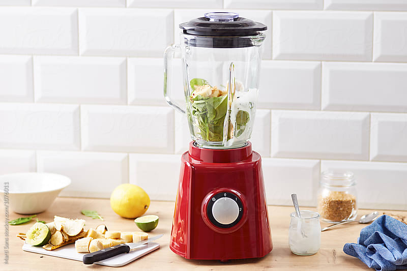 Mixer with spinach leaves inside by Martí Sans for Stocksy United