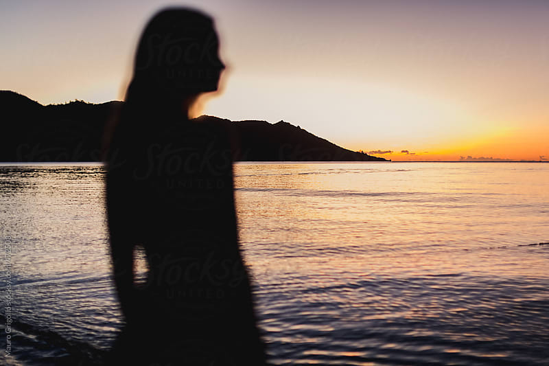 Woman looking at sunset by Mauro Grigollo for Stocksy United