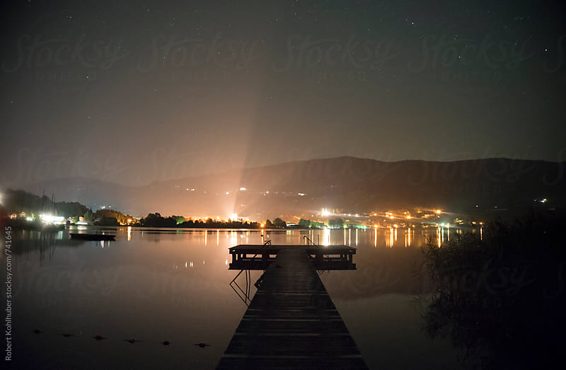 Small dock in Mondsee, austria at night by Robert Kohlhuber for Stocksy United