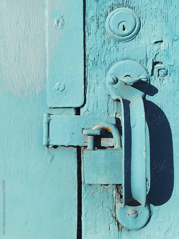 Painted padlock and door handle, close up by Paul Edmondson for Stocksy United