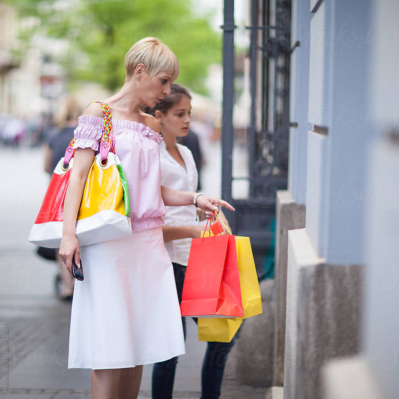 Mother and daughter shopping. by Mosuno for Stocksy United