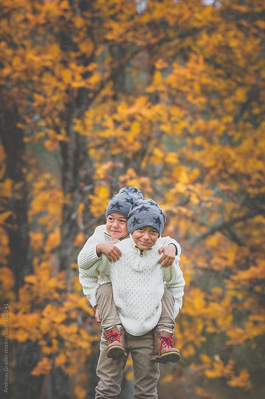 brothers in autumn setting by Andreas Gradin for Stocksy United