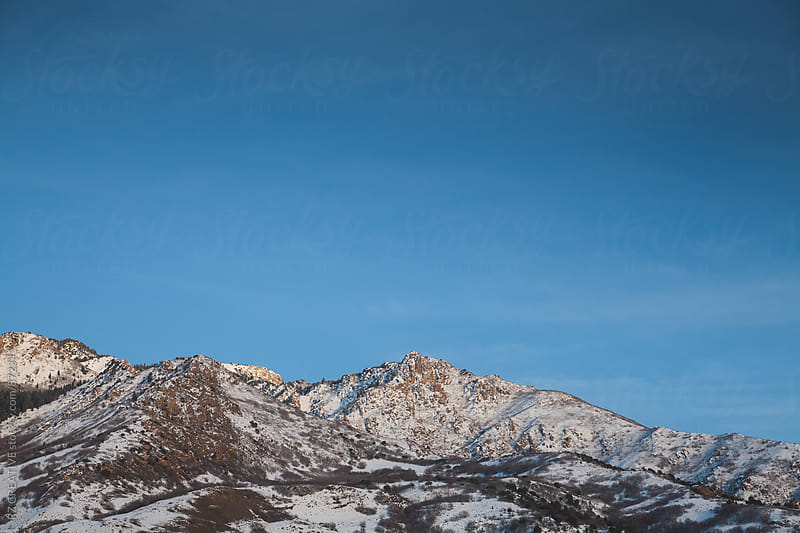 Snow covered mountains in the high desert. by Robert Zaleski for Stocksy United