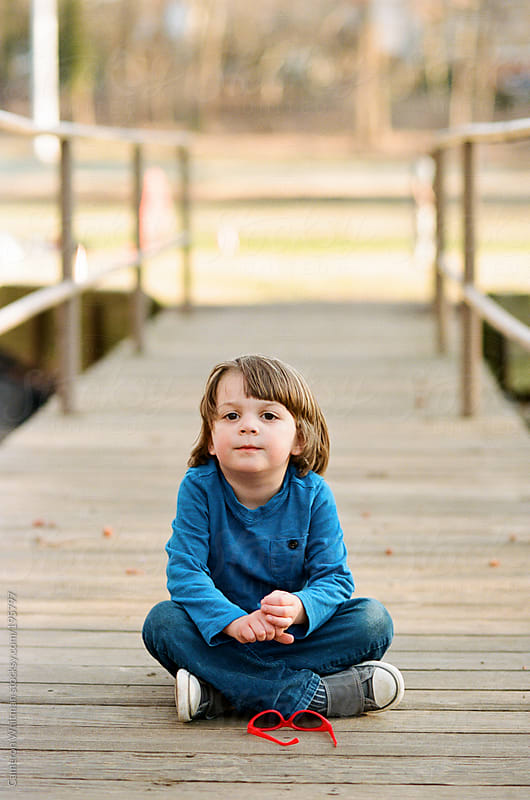 Young boy portraits outdoors on a bridge by Cameron Whitman for Stocksy United