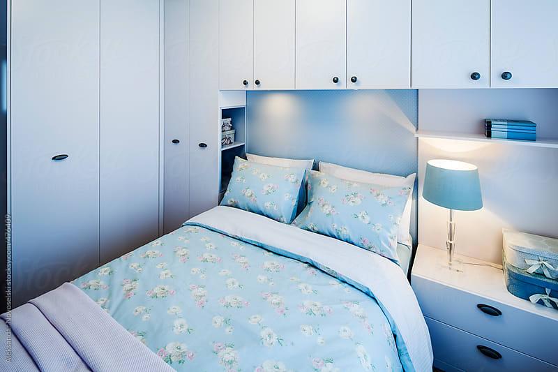 Eclectic bedroom in blue colours by Aleksandar Novoselski for Stocksy United