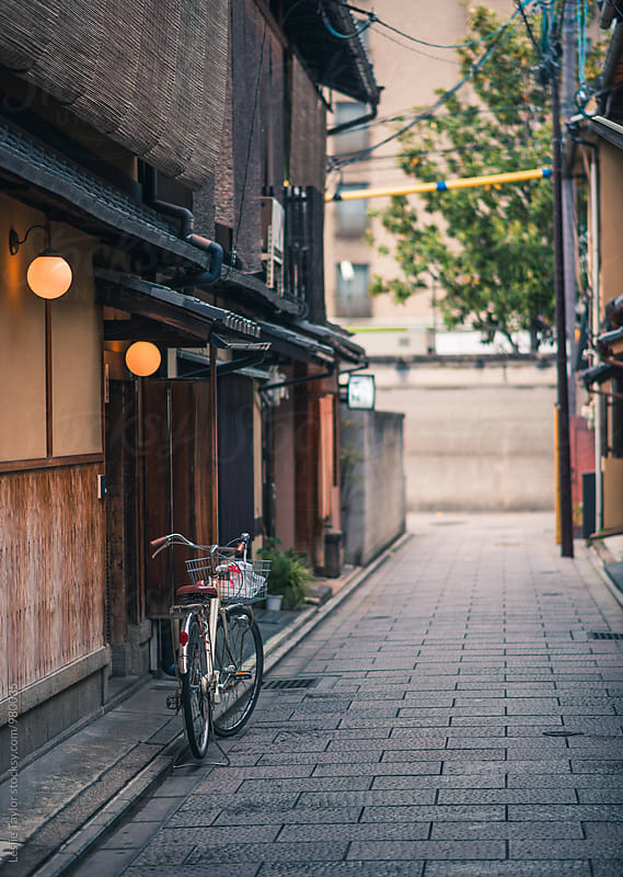 A Bike On A Side Street In Kyoto Japan by Leslie Taylor for Stocksy United