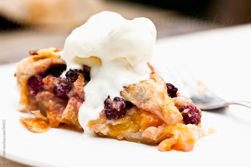 Peach and Blackberry Pie by Jill Chen for Stocksy United