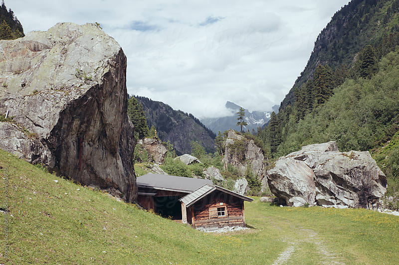 Wooden farmer hut with landscape in austria by Robert Kohlhuber for Stocksy United