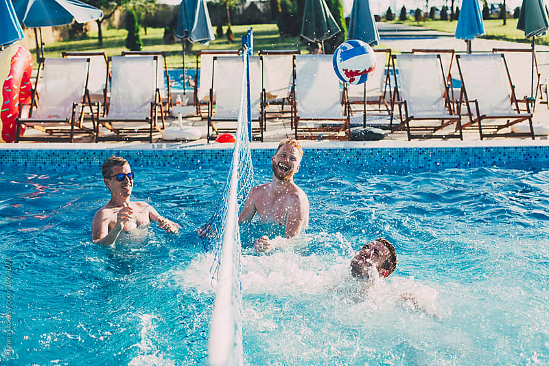 Group of People Playing Volleyball in the Swimming Pool