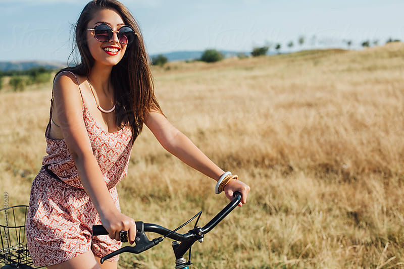 Happy Woman Riding a Bicycle by Lumina for Stocksy United
