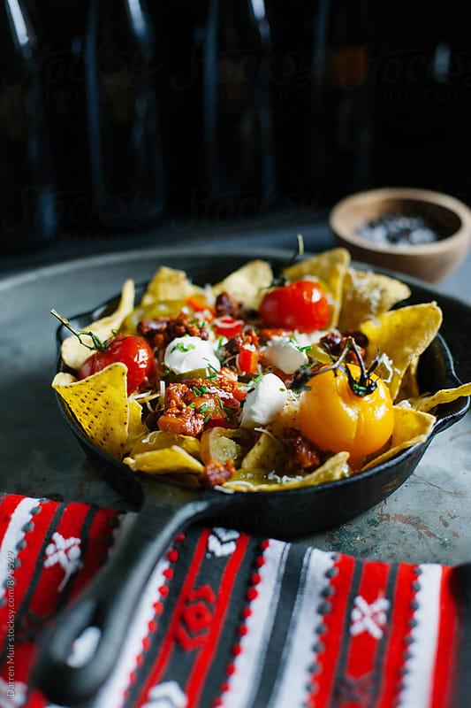 Nachos. Beef chili nachos. by Darren Muir for Stocksy United