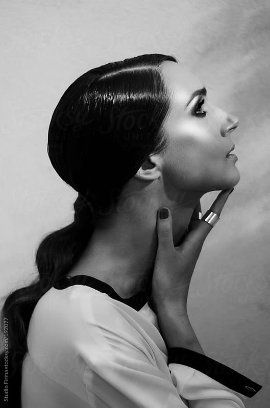 Black and white portrait of a beautiful elegant woman by Studio Firma for Stocksy United
