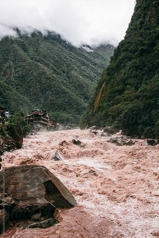 River with raging waters in Aguas Calientes, Peru by Alejandro Moreno de Carlos for Stocksy United