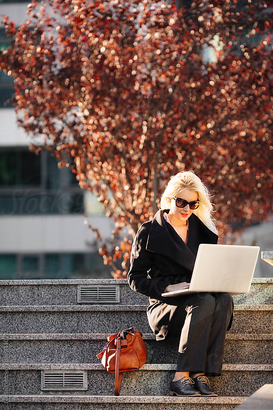 Beautiful Woman Sitting With Her Laptop by Lumina for Stocksy United