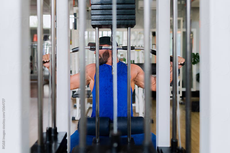 Man doing weight training at the gym by RG&B Images for Stocksy United