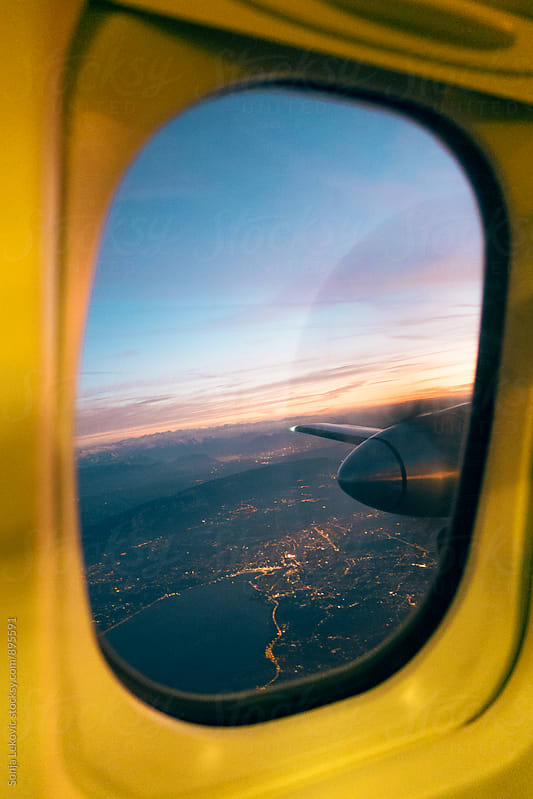 airplane window view by Sonja Lekovic for Stocksy United
