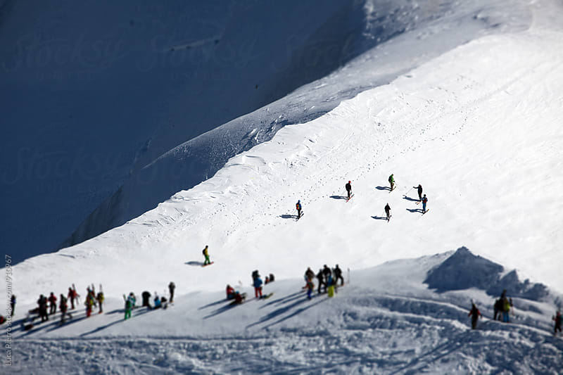Skiers on Mont Blanc, Aiguille du Midi by Luca Pierro for Stocksy United