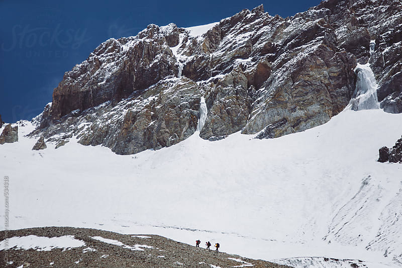 Three hikers in the Andes mountains with snow by Chris Werner for Stocksy United