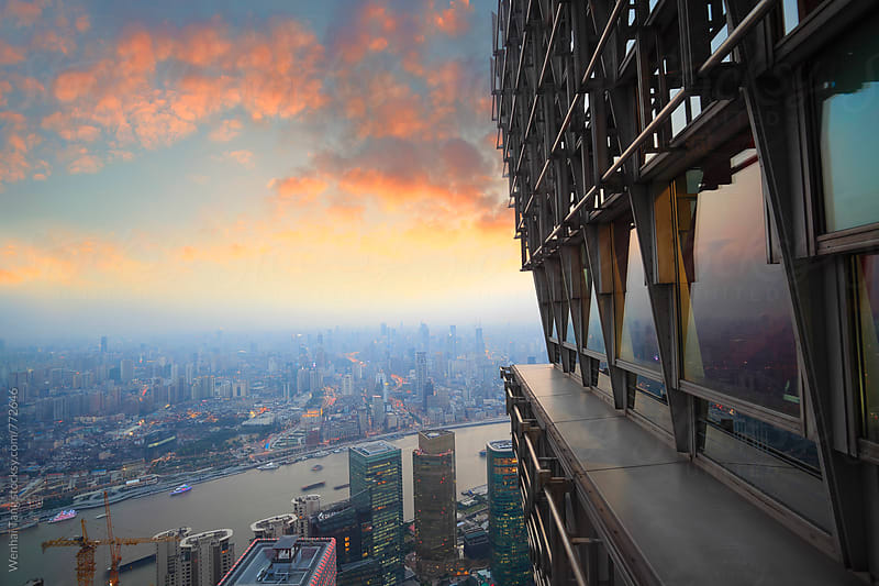 Bird view at Shanghai China. Skyscraper under architectural in foreground. by Wenhai Tang for Stocksy United